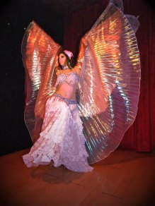Nefabit performing with double Isis Wings