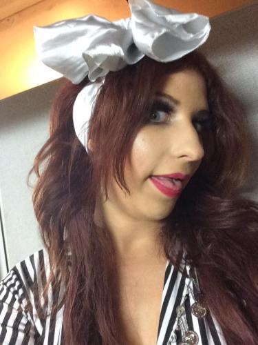 A big bow needs a big dorky face. Folkloric costume, backstage at Azars